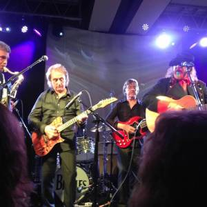 Onstage: Mark Rivera, Denny Laine, Joey Molland and Mark Hudson. (Photo by Jude Southerland Kessler)