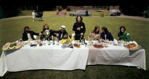 A Last Supper-style album photo of Harrison and friends at Friar Park.